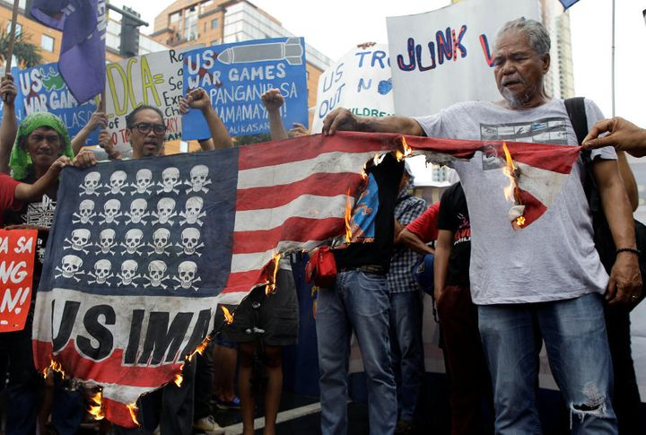 Demonstrators burn a mock U.S. flag during a rally opposing the U.S.-Philippines joint military exercises outside the U.S. embassy in Manila, Philippines, on October 4