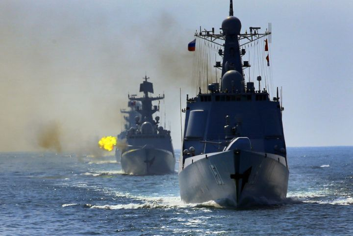 Chinese and Russian fleets fire main guns during a China-Russia naval joint drill at sea off south China's Guangdong Province, on September 18