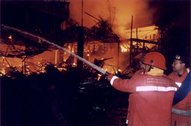 The Sari Club blazes after a bomb detonates in