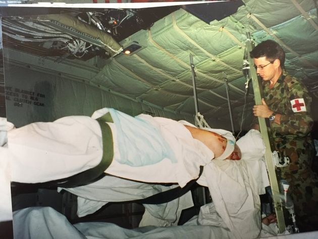 Read tends to a patient on the back of a Hercules