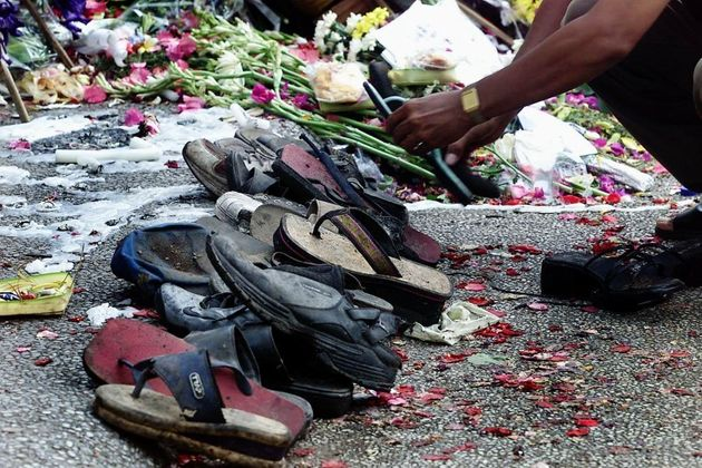 Shoes found at the remains of The Sari Club are placed by a shrine in October