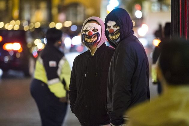 These men are dressed up on Halloween, but many are dressing up for the clown craze which is deemed anti-social...