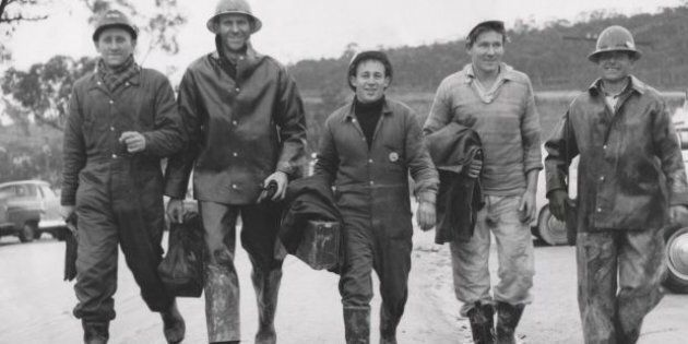 Workers return after a day's work in June 1957 on the snowy