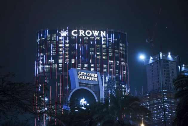 The City of Dreams complex, operated by Melco Crown Entertainment Ltd., stands illuminated at night in...