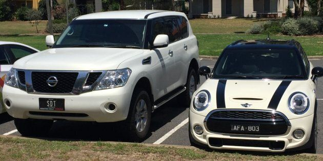 A Nissan Patrol with registration SDT and a white Mini Cooper with registration AFA 803 was