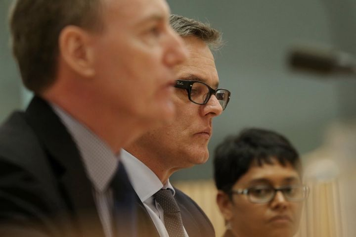 Kerry Purcell (centre), managing director of IBM Australia, with colleagues Michael Shallcross and Permenthri Pillay during the hearing on Tuesday