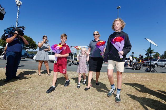 The baker family lay flowers at Dreamworld, where four people were killed following an accident on the...
