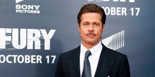 Cast member Brad Pitt arrives on the red carpet at the premiere of World War II film