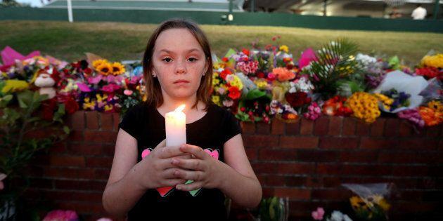 Ella Cowen attends a candlelit vigil outside Dreamworld on the Gold Coast,