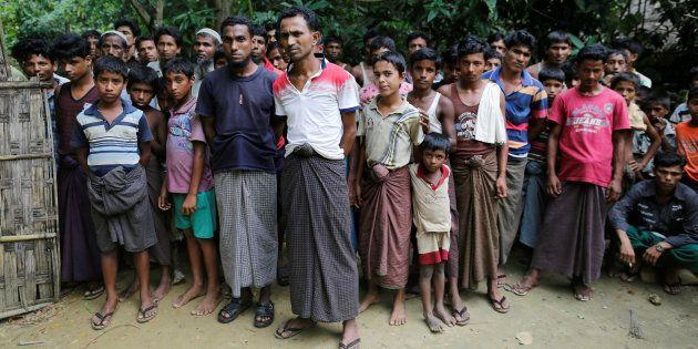 Rohingya Muslim men stand at U Shey Kya village outside Maugndaw in Rakhine state, Myanmar October 27, 2016.