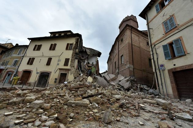 The collapsed bell tower of the Santa Maria in Via church in Camerino where 80 per cent of houses were...