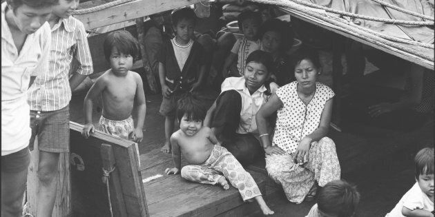 Children and women in cabin on a boat from Vietnam, in Darwin in