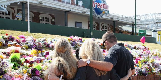 Staff members paid tribute to the victims and their families outside Dreamworld on Friday.