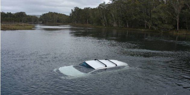 A man accidentally crashed into Lake Cathie on the NSW Mid North Coast after a fright from a spider.