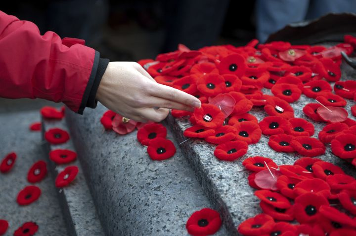 Poppies being laid on the tomb of the unknown soldier on remembrance day.