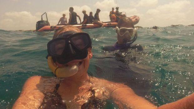 Elly Warren diving in Africa. According to friends, she was a loving, adventurous young