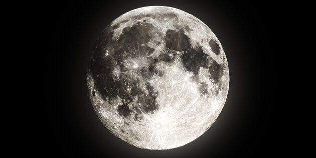 Full super moon over dark black sky at night taken on 18 august 2016. Super moons happen regularly but...