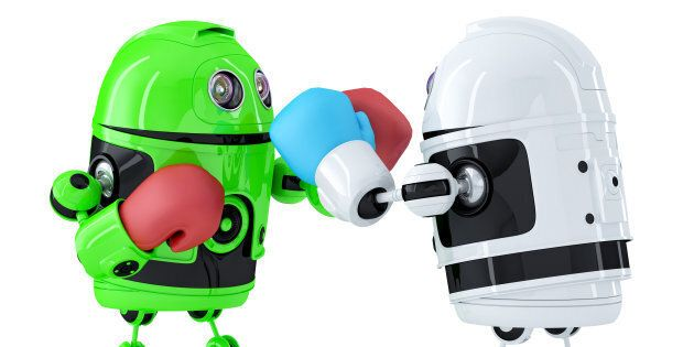 Toy robots fighting. Technology concept. Isolated over white. Contains clipping path