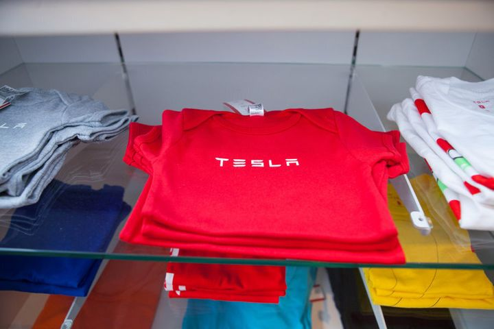Yes, that is a Tesla baby outfit.
