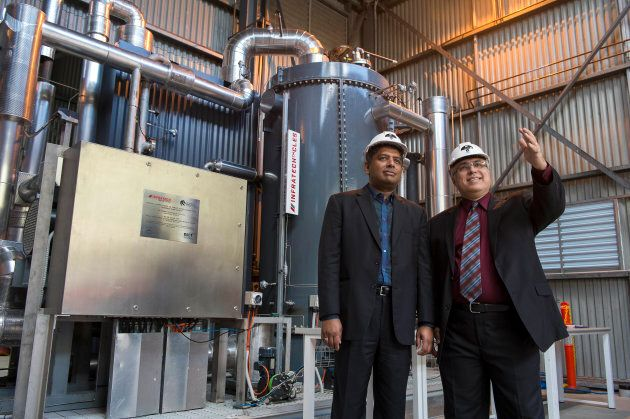 Entrepreneur Dr Rajesh Nullore with Professor Behdad Moghtaderi from the University of Newcastle inspecting...