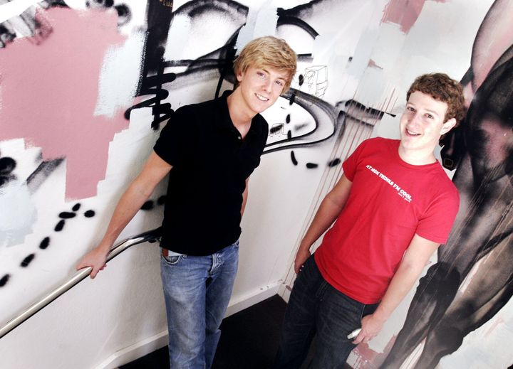 Chris Hughes (left) and Mark Zuckerberg (right) pose for a picture at their Palo Alto office in 2005.