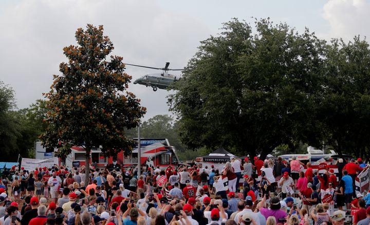 Trump supporters cheer as the president's helicopter lands in Panama City Beach, Florida on May 8, 2019.