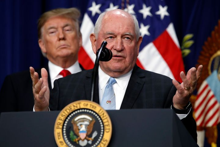 President Donald Trump listens to Agriculture Secretary Sonny Perdue speak in December. A group of USDA employees voted to un