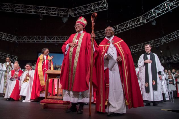 Rev. Phoebe Roaf (center), flanked by Bishop Michael B. Curry, is consecrated a bishop in Hope Church...