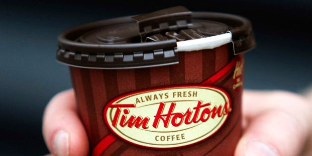 A cup of Tim Hortons Inc. coffee is displayed for a photograph in Toronto, Ontario, Canada, on Wednesday,...