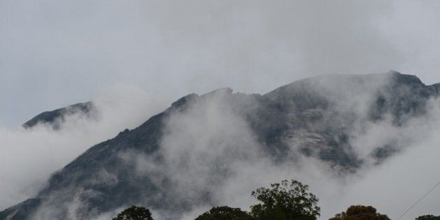 Malaysia's Mount Kinabalu is seen among mists from the Timpohon gate check point a day after the earthquake...