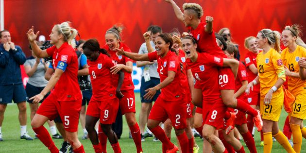 EDMONTON, AB - JULY 4: Team members from England react to their win over Germany during the FIFA Women's World Cup Canada 3rd Place Play-off match between England and Germany at Commonwealth Stadium on July 4, 2015 in Edmonton, Alberta, Canada.  (Photo by Todd Korol/Getty Images)