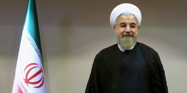 Iran's President Hassan Rouhani waits to greet the International Atomic Energy Agency's director-general,...