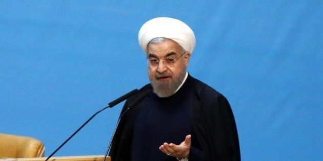 TEHRAN, IRAN - JANUARY 4: Iranian President Hassan Rouhani speaks during the opening ceremony of the...