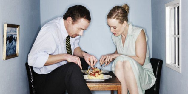 Couple eating dinner in small dining
