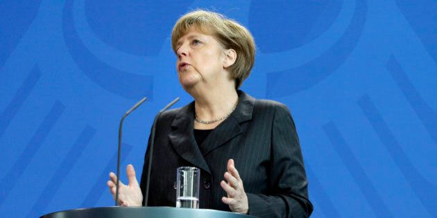 German Chancellor Angela Merkel addresses the media during a joint news conference after a meeting with the Prime Minister of Iraq, Haider al-Abadi, at the chancellery in Berlin, Germany, Friday, Feb. 6, 2015. (AP Photo/Michael Sohn)