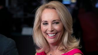 FILE - In this Oct. 22, 2018, file photo, former CIA operative Valerie Plame is interviewed on the floor of the New York Stock Exchange. Plame has decided to run for the Democratic nomination to an open congressional seat in New Mexico. Plame told The Associated Press on Thursday, May 9, 2019, that she wants to give back to a community that welcomed her after leaving Washington in 2007. (AP Photo/Richard Drew, File)