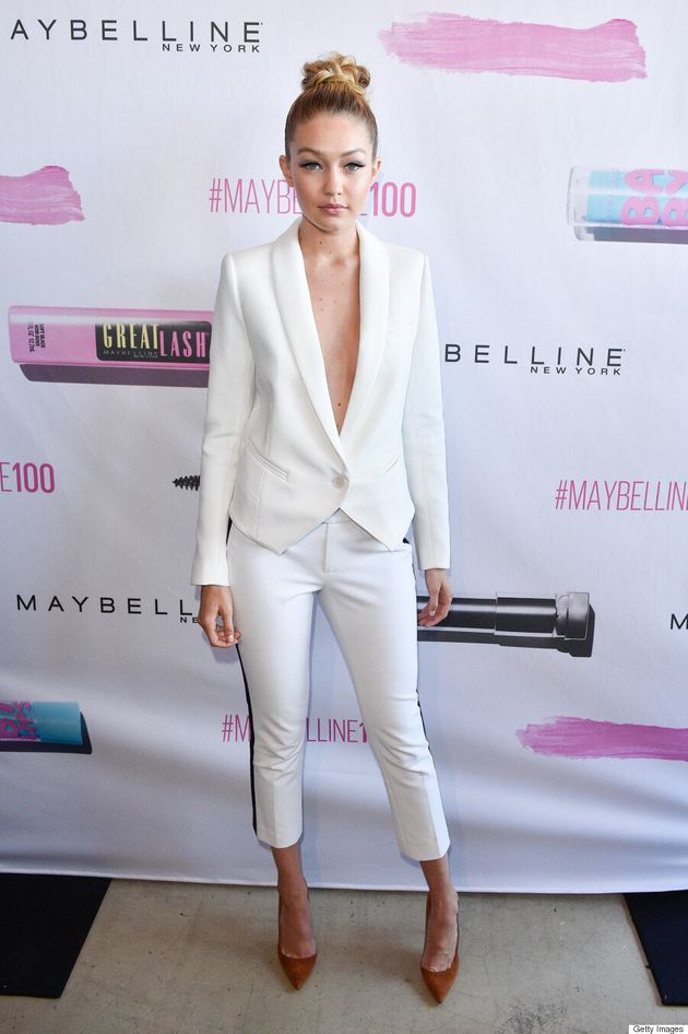 Gigi Hadid Stuns In White Pantsuit At Maybelline 100 Party In