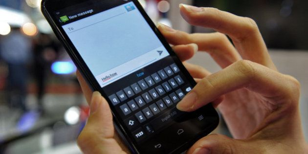 To go with Asia-telecom-SMS-technology-Internet by Martin AbbugaoThis photo, taken on June 21, 2012,...
