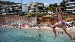 As Greeks Live Through Disaster, Tourists Hit The