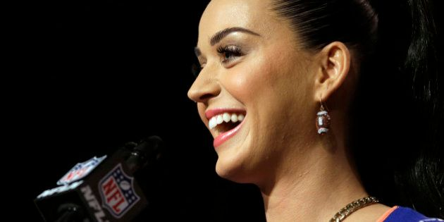 Katy Perry smiles at a halftime news conference for NFL Super Bowl XLIX football game Thursday, Jan. 29, 2015, in Phoenix. (AP Photo/David J. Phillip)