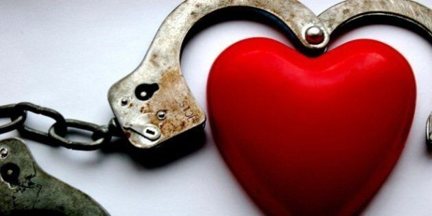 Description Love hurts | Source http://www. flickr. 13933554@N05/2409474974/ alot like LOVE. |  ... Category:Handcuffs in BDSM Category:Heart symbols.