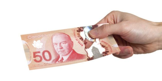 What Do Canadians Do With Extra Cash? Pay Off Debts, Report