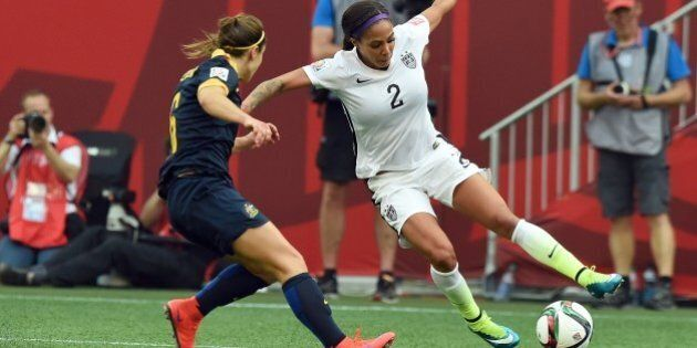 Forward Sydney Leroux of the USA (R) vies for the ball with Australian defender Servet Uzunlar during...