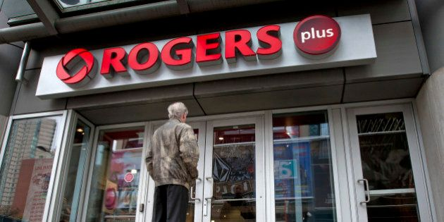 A customer waits for a Rogers store to open on Yonge Street in Toronto, Ontario, Canada, on Tuesday,...