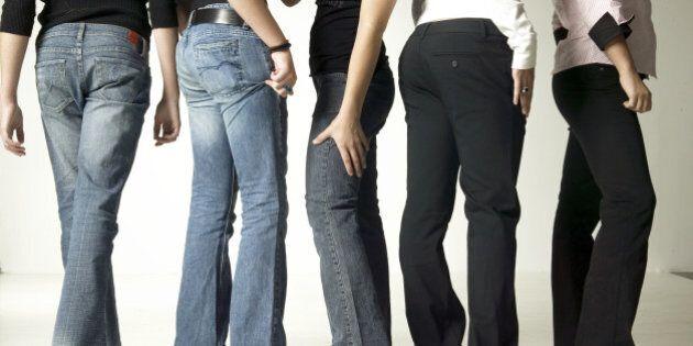 Women wearing denim jeans, posing in studio, low