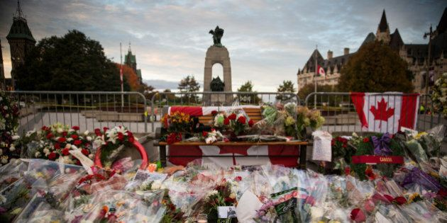 OTTAWA, ON - OCTOBER 23: Flowers and wreaths are left in memorial of Cpl. Nathan Cirillo of the Canadian...