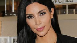 Kim Kardashian Covers Up For