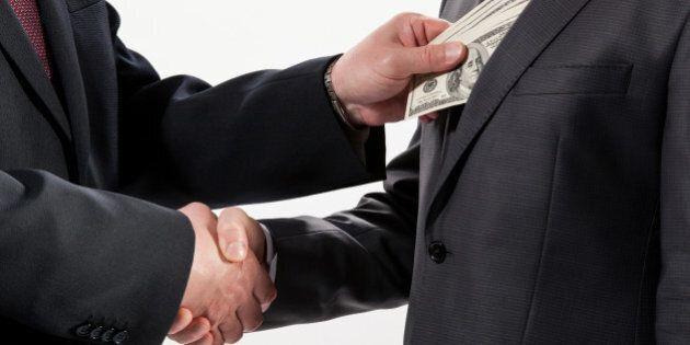 giving a bribe into a pocket  ...