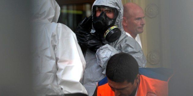 Chemical and biological experts prepare to intervene on October 24,2014 at the German Consulate in Istanbul....