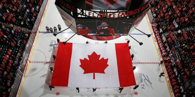 CALGARY, AB - OCTOBER 23: A giant Canadian flag is displayed in a moment of silence for the Ottawa shooting...